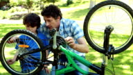Father and son fixing bike video