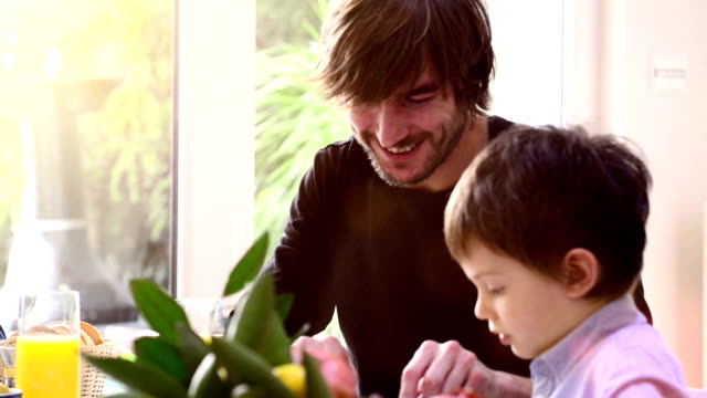 Father and son having breakfast video