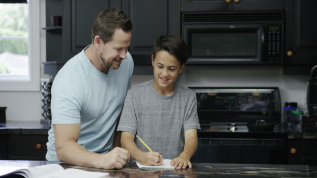 Father and Son in Kitchen video
