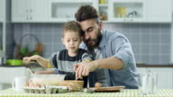 Father and son in the kitchen video