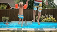 SLO MO DS Father and son jumping into the pool video