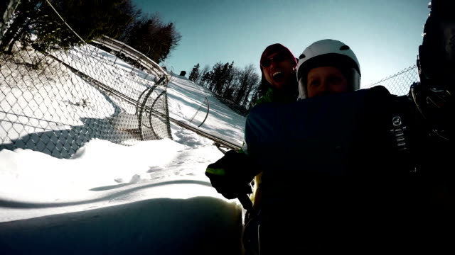 Father and son on the Bobsleigh attraction during winter holiday. video