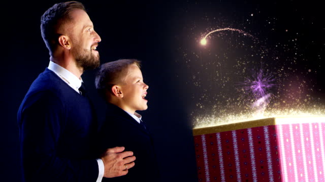 Father and son opening Christmas gift video