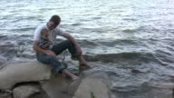 Father and son play at waters edge video