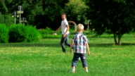 Father and son playing ball in the park video