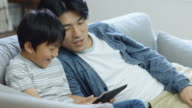 Father and Son Playing Computer Game Together video