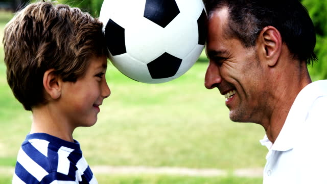 Father and son playing football video