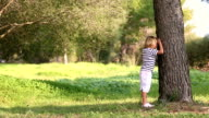 father and son playing hide and seek outdoors video