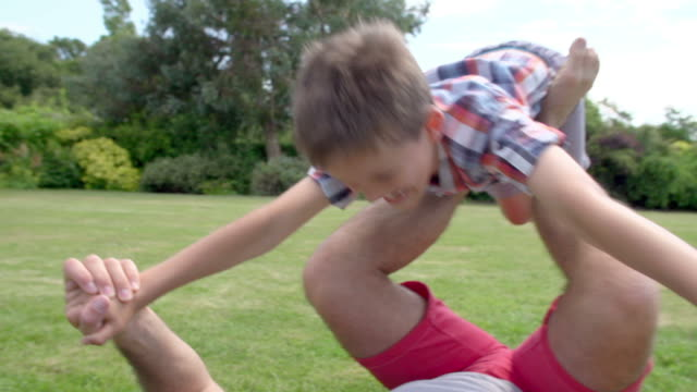 Father And Son Playing In Garden At Home Together video