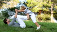 Father and son playing in the meadow video
