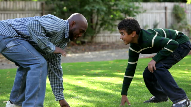 Father and son playing in yard video