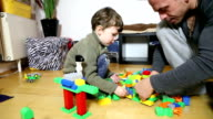 Father and Son playing lego video