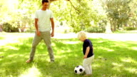 Father and Son playing soccer video