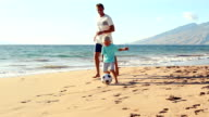 Father and Son Playing Together at the Beach at Sunset. video