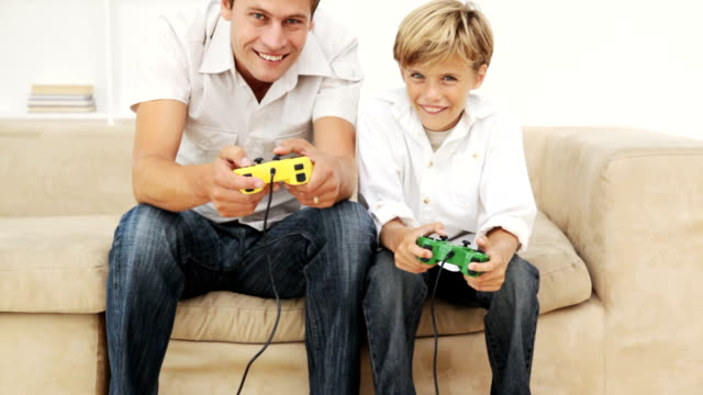 Father and Son Playing Video Games video