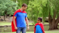 Father and son pretending to be superheroes video