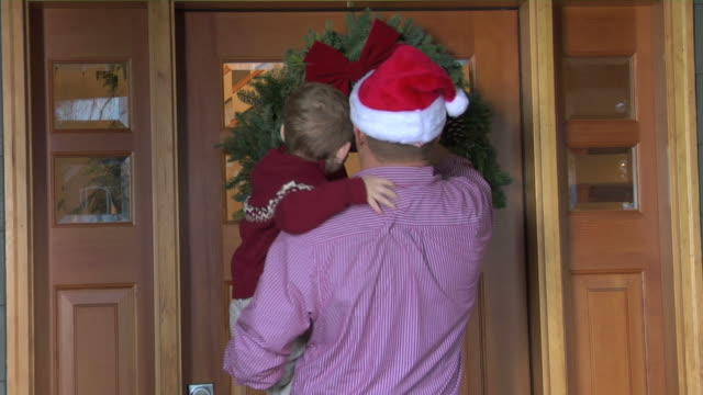 Father and Son put wreath on door video