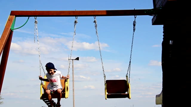 father and son ride on the swing, swing with an iron chain video