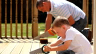 Father and son sawing video