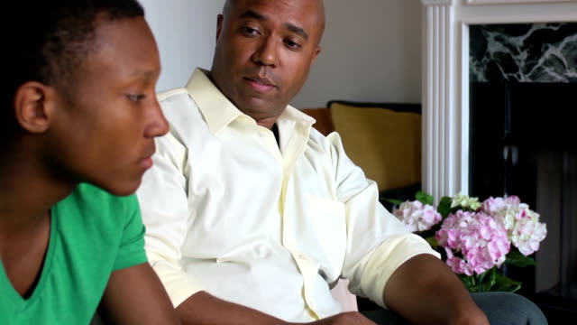 Father and Son Serious Conversation - Angle on Father video