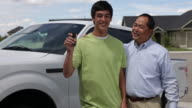 Father and son, teen holds up keys to truck video