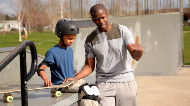 Father and son together at skateboard park video