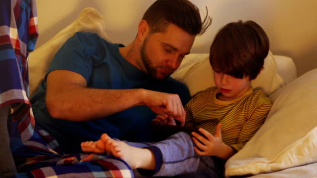 Father and Son Using Digital Tablet video
