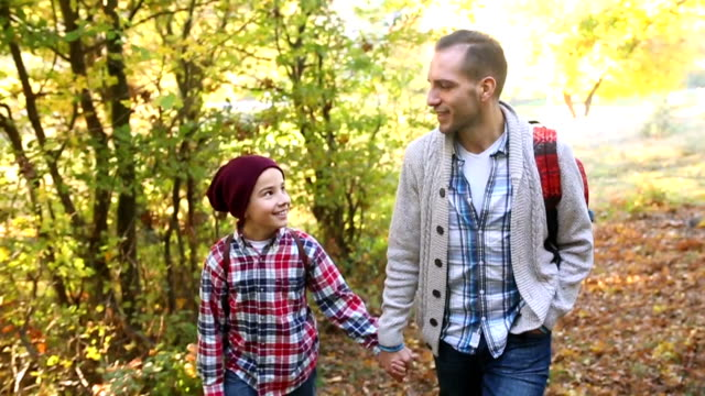 Father and son walking in nature video