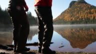 Father and Son walking on Lake Shore, Autumn Season video