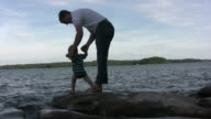Father and Son walking to water video