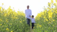 Father and son walking together video