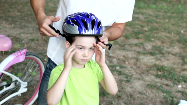 HD: Father Assisting Child With Cycling Helmet. video