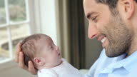 Father At Home With Newborn Baby Daughter video