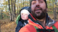 Father Backpacking Hiking with Baby in Autumn Forest video