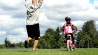 Father Celebrates Daughter Riding Bike Without Training Wheels video