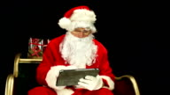 Father Christmas, Santa in sleigh on Tablet, wide video