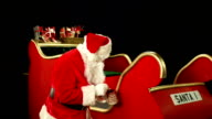 Father Christmas, Santa painting his sleigh ready for use video