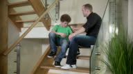 Father comforts his son video