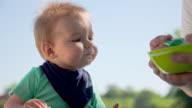 CU Father Feeding A Baby video