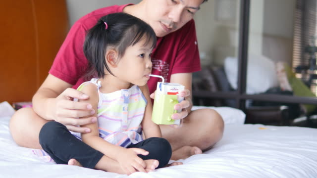 4K : Father feeding his baby video