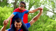 Father giving piggy back to son video