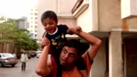 Father giving piggyback ride to his son video
