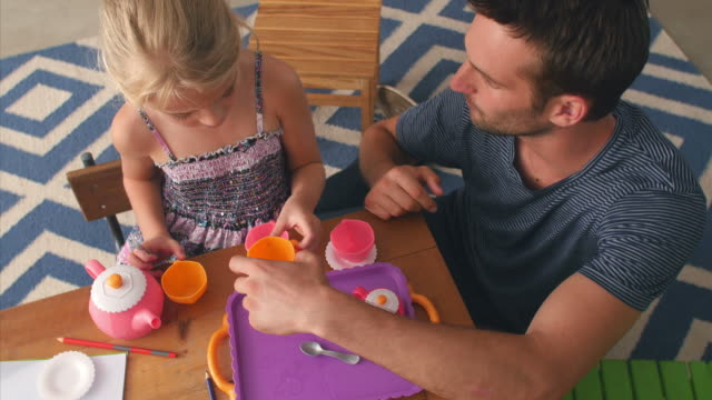 Father Having Tea Party With Daughter In Bedroom video