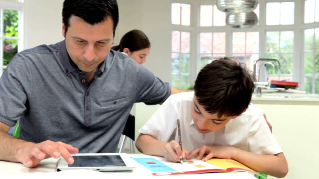 Father Helping Children With Homework video