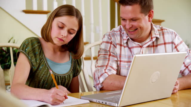 Father helping daughter with homework video