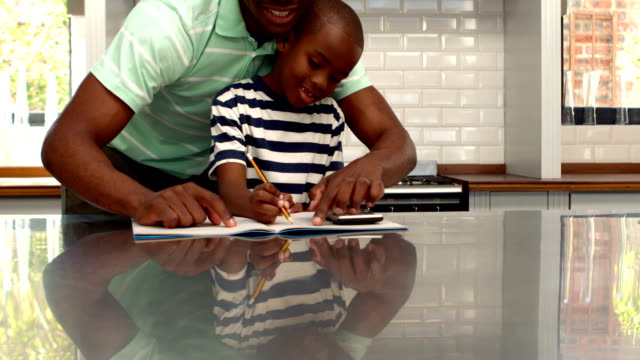 Father helping his son with homework video