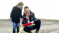 MS Father helping son for making kite video