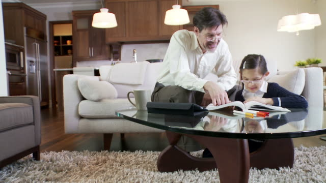 Father helps daughter with home work video