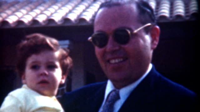 Father Holding Son 1958 video