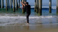 Father Lifts Son Up Over the Water video